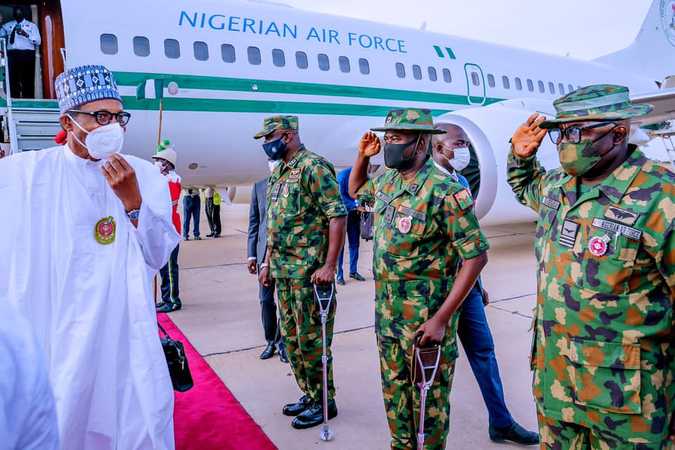 President Buhari inspecting guard of honour on his arrival in Kastina on Friday